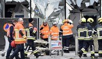 Broken windows of the terminal at Brussels national airport are seen during a ceremony following bomb attacks in Brussels metro and Belgium's National airport of Zaventem, Belgium, March 23, 2016.