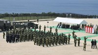 Members of Japan's Self Defence Force hold an opening ceremony of a new military base on the island of Yonaguni in the Okinawa prefecture, March 28, 2016.