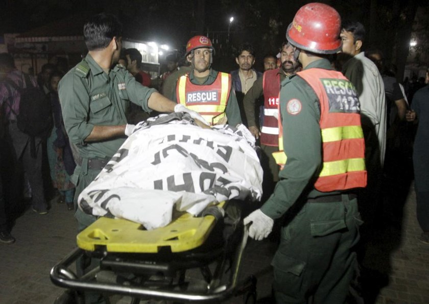Rescue workers move a body from the site of a blast outside a public park in Lahore, Pakistan, March 27, 2016.