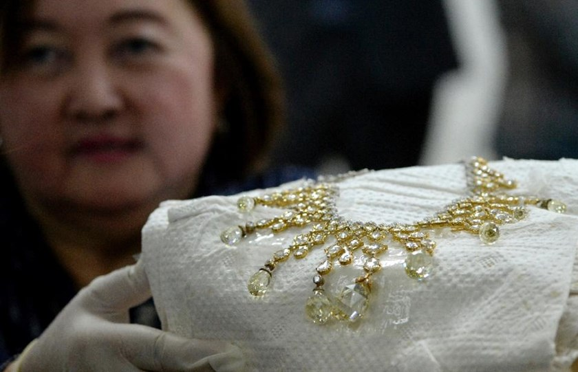 An official from the Presidential Commission on Good Government shows a diamond-studded piece of jewellery seized by the Philippine government from former first lady Imelda Marcos