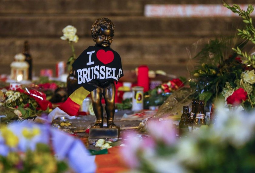 A replica of the Manneken-Pis statue, a major Brussels tourist attraction, is seen among flowers at a memorial for the victims of bomb attacks in Brussels metro and Brussels international airport of Zaventem, in Brussels, Belgium, March 28, 2016.