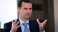 A picture released by the official Syrian Arab News Agency on March 30, 2016 shows President Bashar al-Assad speaking to a journalist during an interview with Russia's RIA Novosti state news agency