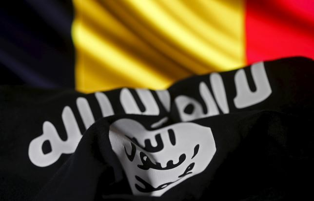 Islamic State flag is seen in front of a Belgian flag in this illustration taken March 22, 2016.