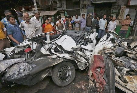 People look at wreckage caused when an under-construction flyover collapsed in Kolkata