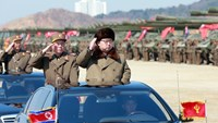 North Korean leader Kim Jong-Un (front R) inspects a striking drill at an undisclosed location
