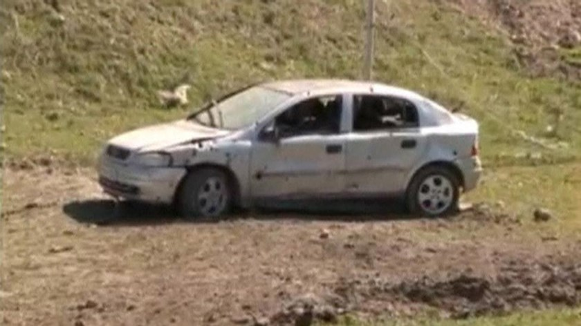 A car which was damaged during clashes between Armenian and Azeri forces is seen in Nagorno-Karabakh region, which is controlled by separatist Armenians, in this still image taken from video provided by the Nagorno-Karabakh region Defence Ministry April 2, 2016.