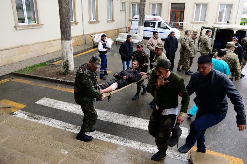 Azeri servicemen bring their comrade, who was wounded during clashes with Armenian forces in the region of Nagorny Karabakh, to a hospital in the town of Terter, Azerbaijan, on April 3, 2016