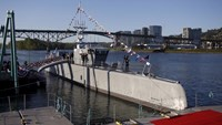The autonomous ship 'Sea Hunter', developed by DARPA, is shown docked in Portland, Oregon before its christening ceremony April 7, 2016.