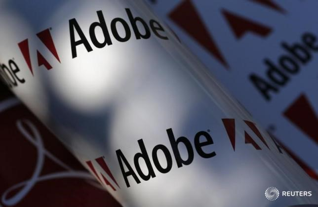 Adobe company logos are seen in this picture illustration taken in Vienna July 9, 2013.