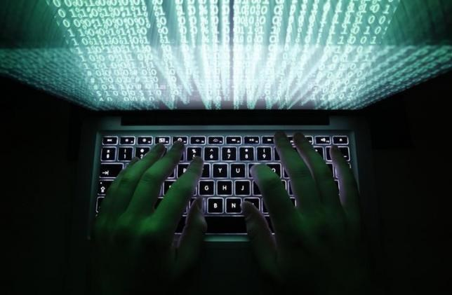 A man types on a computer keyboard in Warsaw in this February 28, 2013 illustration file picture.