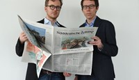 "German journalists Frederik Obermaier (L) and Bastian Obermayer (R) co-authors of the socalled ""Panama Papers"" investigation pose on April 7, 2016 in Munich, at the office of the German daily Sueddeutsche Zeitung"