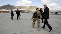 U.S. Secretary of State John Kerry (R) walks upon arrival at Kabul International Airport for a day of meetings with Afghan leaders in Kabul April 9, 2016.