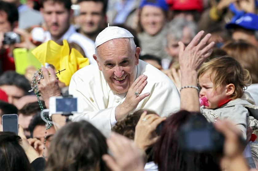 Pope Francis waves as he arrives at a Jubilee audience in Saint Peter's Square at the Vatican April 9, 2016.