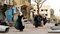 Syrians returned to their homes in Palmyra, ten months after fleeing when jihadist seized the city
