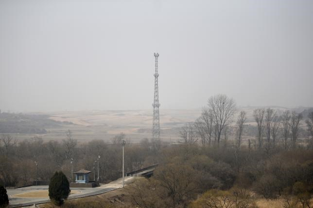 North Korea's surveillance cameras sit on the top of a steel tower to overlook the south, near the truce village of Panmunjom, South Korea, March 30, 2016.