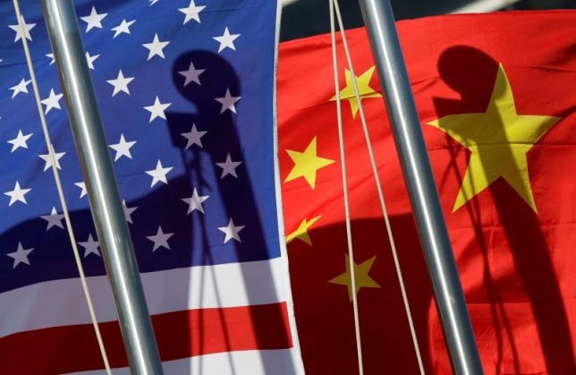 National flags of the U.S. and China are seen in front of an international hotel in Beijing January 17, 2011.