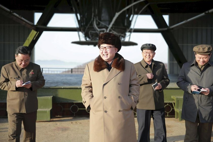 North Korea leader Kim Jong Un smiles as he visits Sohae Space Center in Cholsan County, North Pyongan province for the testing of a new engine for an intercontinental ballistic missile (ICBM) in this undated photo released by North Korea's Korean Central News Agency