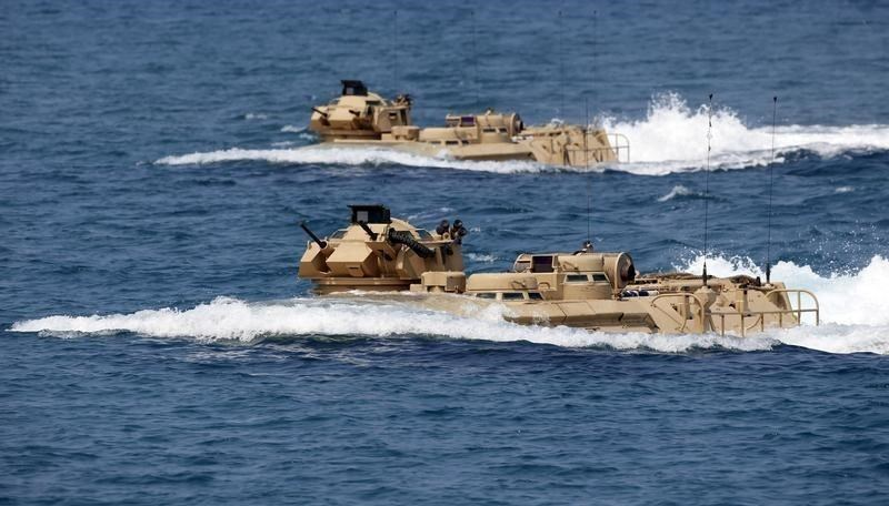 U.S. military forces aboard Amphibious Assault Vehicles (AAV) manuevre on South China Sea near the shore of San Antonio, Zambales during the annual 'Balikatan' (shoulder-to-shoulder) war games with Filipino soldiers in northern Philippines April 21, 2015.