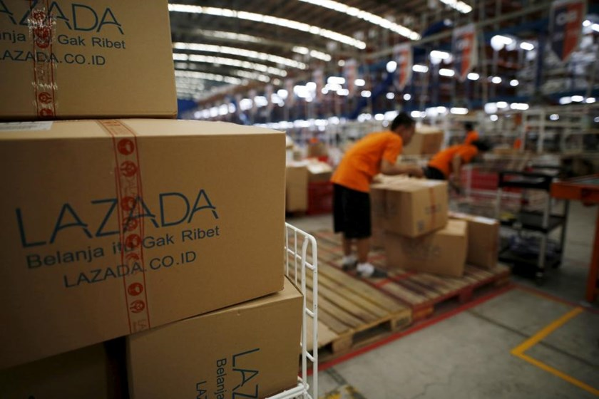 Employees at online retailer Lazada fill orders at the company's warehouse in Jakarta, Indonesia April 15, 2016.