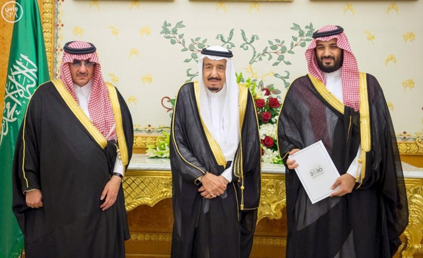 (L-R) Saudi Crown Prince Mohammed bin Nayef, Saudi King Salman, and Saudi Arabia's Deputy Crown Prince Mohammed bin Salman stand together after Saudi Arabia's cabinet agrees to implement a broad reform plan known as Vision 2030 in Riyadh, April 25, 2016.
