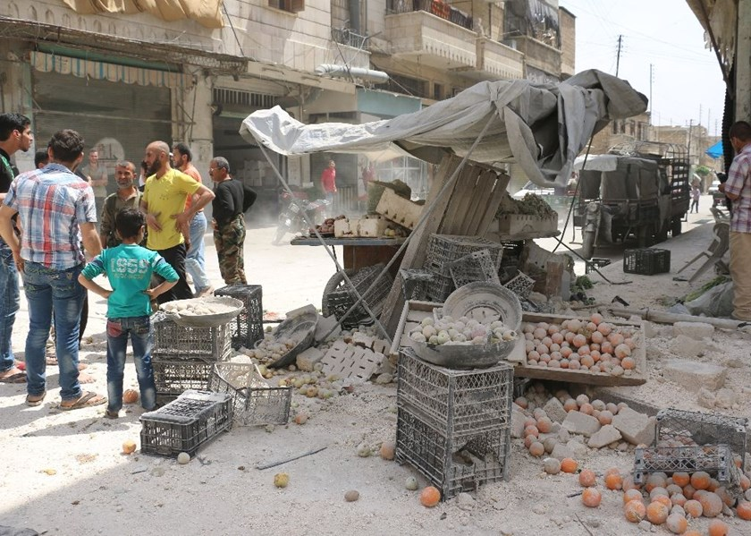 A reported air strike by governement forces hit the rebel-held neighbourhood of Sakhur in Aleppo on April 24, 2016 on a third day of renewed deadly violence in the battered city