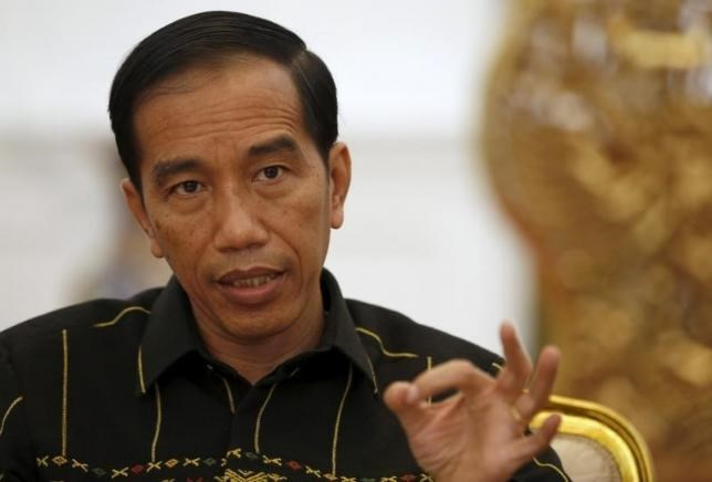 Indonesian President Joko Widodo gestures during an interview with Reuters at the presidential palace in Jakarta, Indonesia February 10, 2016.