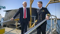 Australian Prime Minister Malcolm Turnbull (L) disembarks an Australian Navy submarine with Australian Navy officer Vice Admiral Timothy Barrett in Adelaide, Australia, April 26, 2016. AAP/Ben Macmahon/via REUTERS
