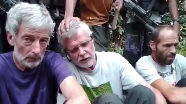 A still image taken from an older video released by Abu Sayyaf militant kidnappers shows Canadians Robert Hall (left) and John Ridsdel (centre). The third male hostage is Norwegian Kjartan Sekkingstad. (Reuters/YouTube )