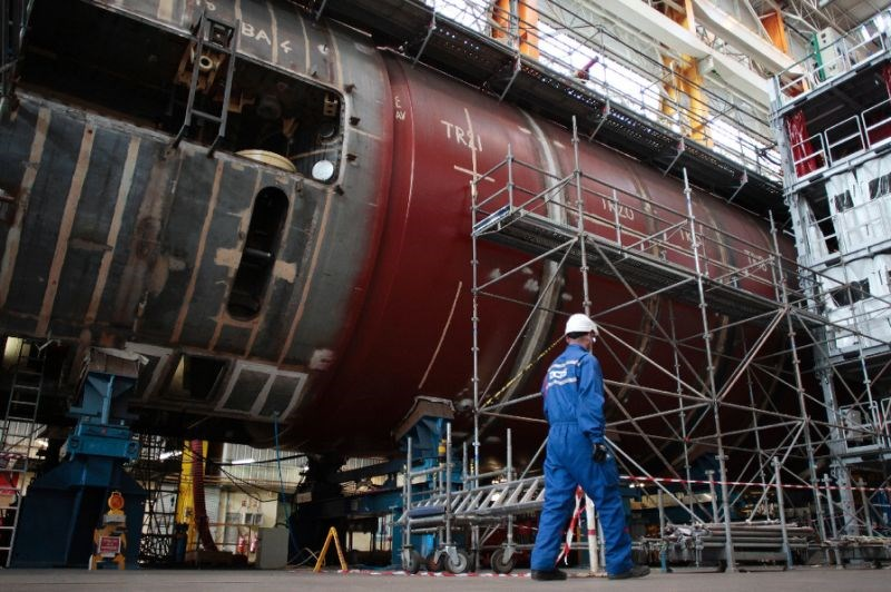 "A technician works on the construction of the nuclear submarine ""SNA Barracuda"" in a plant run by the French industrial group specialised in naval defence and energy, DCNS, in Cherbourg-Octeville"