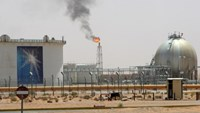 A gas flame is seen in the desert near the Khurais oilfield, about 160 km (99 miles) from Riyadh, June 23, 2008. State oil giant Saudi Aramco is adamant the biggest new field in its plan to raise oil capacity will arrive bang on schedule in June next year.