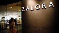 An employee passes by a Zalora sign at their office in Singapore April 5, 2016.