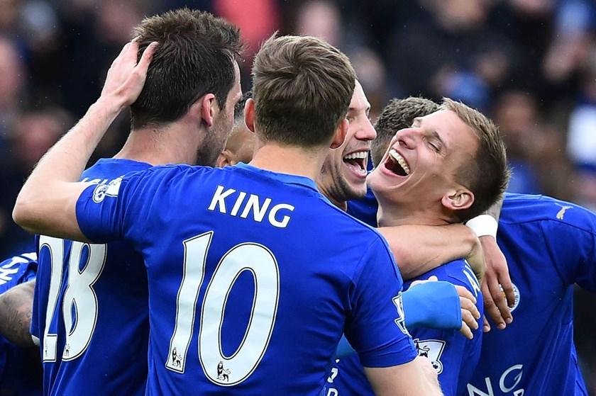 Leicester City's English midfielder Marc Albrighton celebrates scoring their fourth goal during the English Premier League football match between Leicester City and Swansea on April 24. Photo: AFP