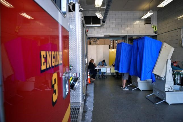 A voter casts his ballot in the Pennsylvania primary at a polling place inside a firehouse in Philadelphia, Pennsylvania, U.S., April 26, 2016.