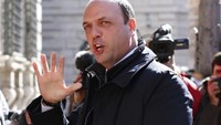 Italy's Interior Minister Alfano arrives for a confidence vote at the Senate in Rome
