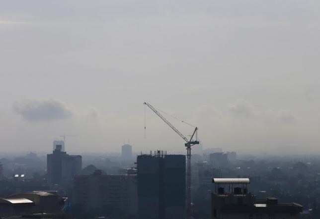 A crane is seen at the construction site of an apartment building in Colombo, Sri Lanka October 14, 2015.