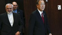 United Nations Secretary General Ban Ki-moon (R) arrives to a meeting with Iranian Foreign Minister Mohammad Javad Zarif at U.N. headquarters in New York, September 18, 2014.