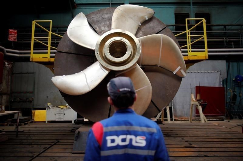 An employee looks at the propeller of a Scorpen submarine at the industrial site of the naval defence company and shipbuilder DCNS in La Montagne near Nantes, France, April 26, 2016.