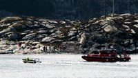 Rescuers work at a site where a helicopter has crashed west of the Norwegian city of Bergen April 29, 2016. NTB Scanpix/Marit Hommedal/via Reuters