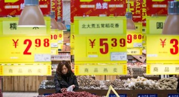 A woman shops in a supermarket in Hangzhou, Zhejiang Province, China, January 19, 2016.