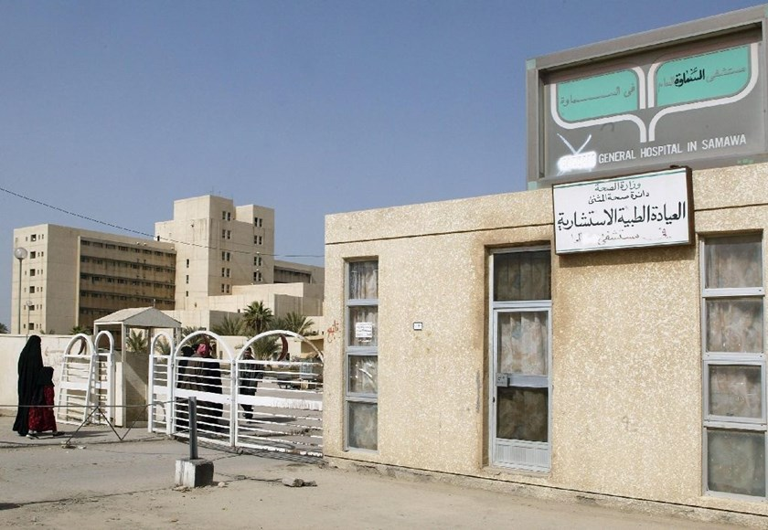 A woman and child enter the general hospital in Samawa, 230 kms south of Baghdad, on February 19, 2004