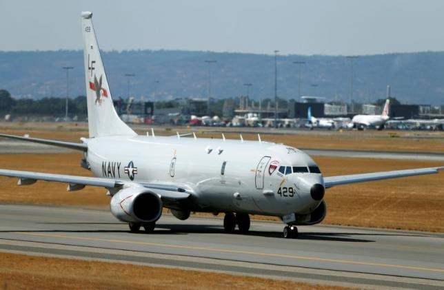 A U.S. Navy Poseidon P8 maritime surveillance aircraft taxis before taking off at Perth International Airport, March 28, 2014.
