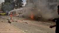 Firefighters try to put out a fire after rockets fired by insurgents hit the al-Dabit maternity clinic in government-held parts of Aleppo city, Syria, in this handout picture provided by SANA on May 3, 2016.