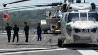 Helicopter crew members of the Japanese helicopter carrier Ise stand on the deck shortly after arriving at the former US naval base, Subic port, north of Manila, on April 26, 2016