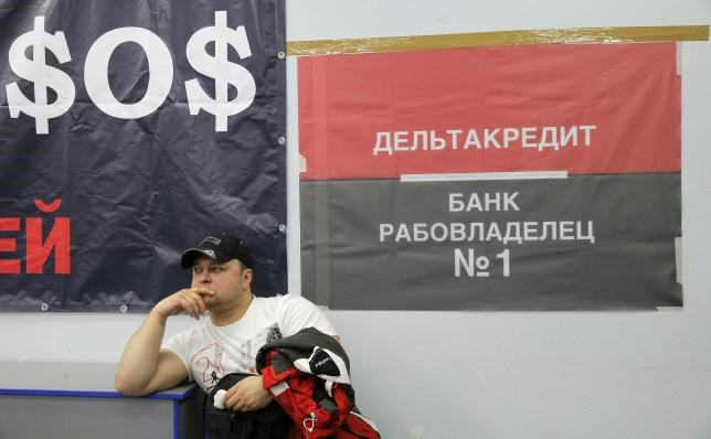 A participant attends a session at the congress of foreign currency mortgage holders in Moscow, Russia, April 6, 2016.