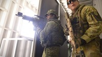 Soldiers from the Singapore Guards (L) and the 7th Australian Regiment clear a room during a dry run of an urban-based exercise at the Urban Operations Training Facility in Shoalwater Bay Training Area, Rockhampton, Australia November 9, 2014. The Straits Times/Mark Cheong/via REUTERS
