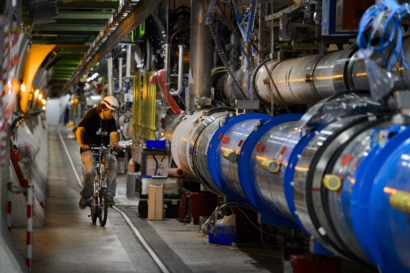A worker rides his bicycle in a tunnel of the European Organisation for Nuclear Research (CERN) Large Hadron Collider during maintenance works in Meyrin, Switzerland on July 19, 2013