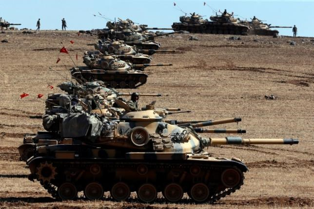 Turkish army tanks take up position on the Turkish-Syrian border near the southeastern town of Suruc in Sanliurfa province October 6, 2014.