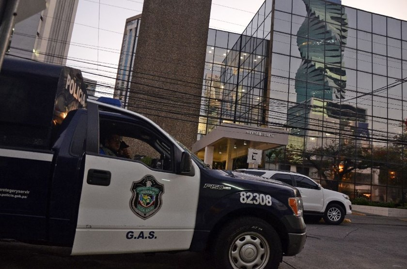 A police car is seen outside the Mossack-Fonseca law firm offices in Panama City during a raid on April 12, 2016