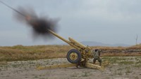 Afghan National Army soldiers fire artillery during a battle with Taliban insurgents in Kunduz, Afghanistan, April 29, 2015.