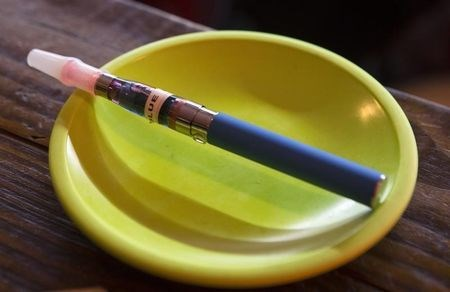 An e-cigarette sits in a tray on the bar at the Henley Vaporium in New York City December 18, 2013.